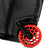 Detail shot of Topo Designs Travel Bag Roller 35L Premium carry-on suitcase in Premium Black showing red roller wheels.