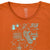 Detail shot of the Women's Short Sleeve Gear Tee in clay orange showing graphic and neckline.