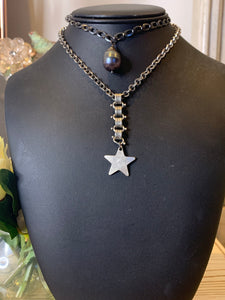 Star necklace on silver book chain.