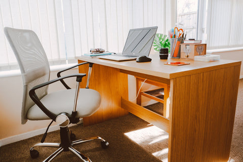 Mesh office chair at desk