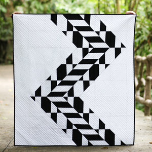 "Photo of ""Tire Tracks"" quilt by Yvonne Fuchs as Quilting Jetgirl photo by Kitty Wilkin @nightquilter"