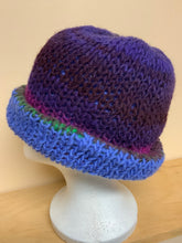 Load image into Gallery viewer, Hand-knit reversible hat, blue on one side, purple shades on the other