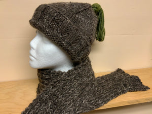Hand-knit brown hat with green tassel and matching scarf