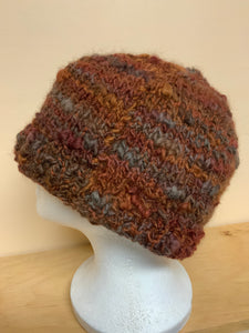 Hand-knit wool hat in shades of brown