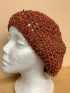 Tan hand-knit hat