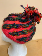Hand-knit hat, pink with dark knit stripes, and Pom Pom on top