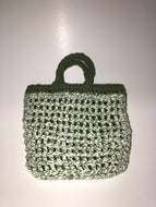 White and green knit bag with green lining
