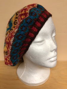 Red, yellow, and blue wool tam hat
