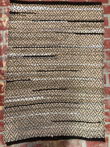 Brown rag rug with diamond weave