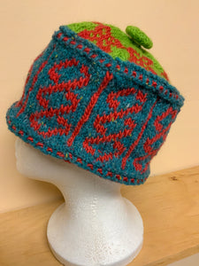Green, teal, and red wool knit hat