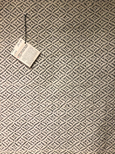 Diamond pattern rug made with cream colored wool