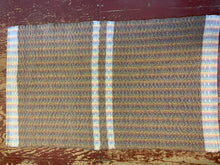 "Load image into Gallery viewer, Brown wool diamond pattern with white wool stripes on rainbow warp: 26"" x 43"""