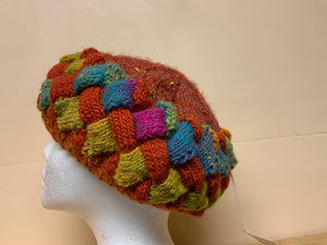 Rust and green knitted hat