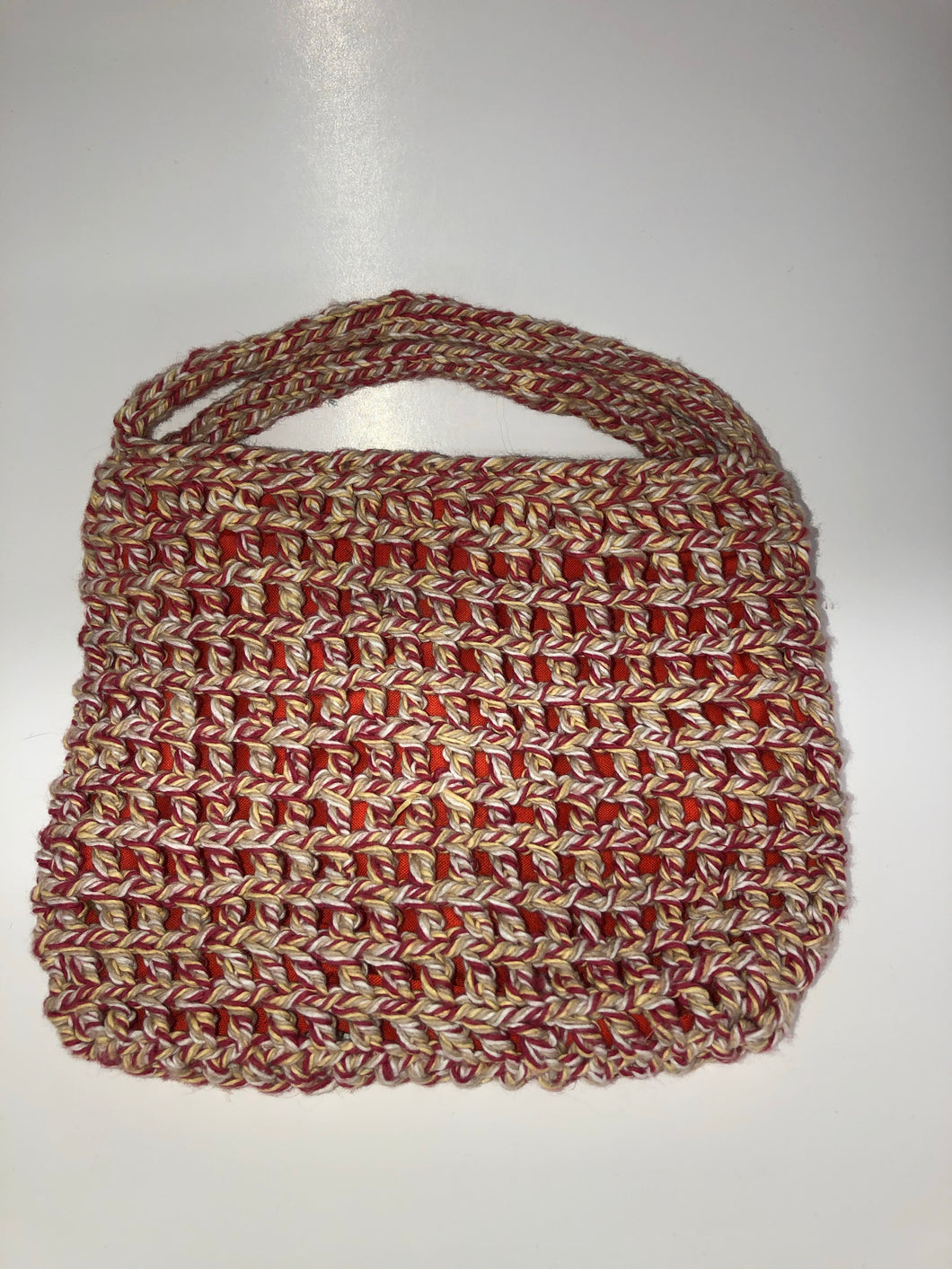 Red and white knit bag with orange lining