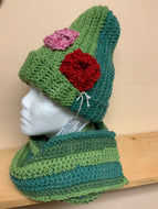 Crocheted hat in shades of green, with matching scarf