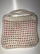 White knit bag with pink lining