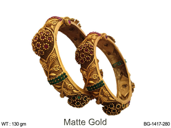 Matta gold ruby green kemp bangle