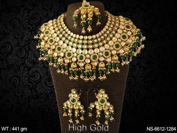 Bridal ruby green clustered heavy kundan necklaces set