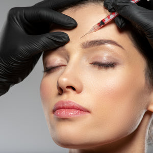 Dysport injection woman frown lines wrinkles