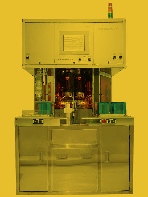 e.  Fully automatic four-axis developing and fixing machine