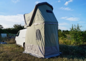 Roof-top annex protects from the rain and gives privacy for a camping toilet
