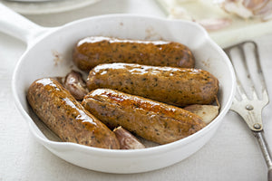 Veggie sausages with caramelised red onions, beans and lentils