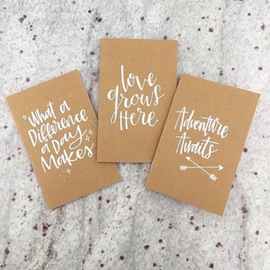 Hand Lettering in White Ink on our Kraft Brown Notebooks