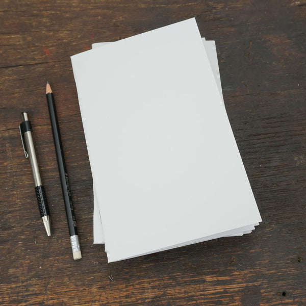White Staple-Bound Notebook