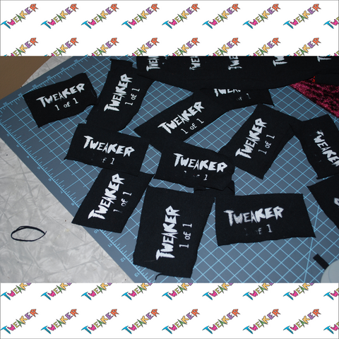 First set of tags produced. Screen printed onto an old tee.
