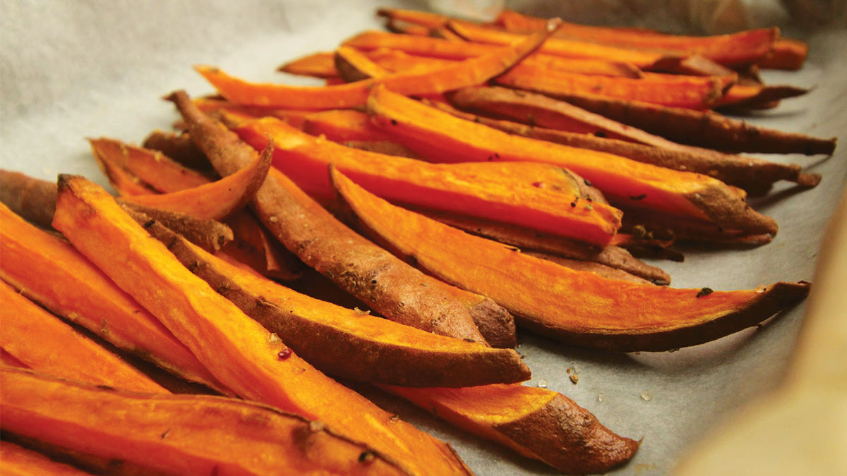 A pan with a row of roasted sliced sweet potato