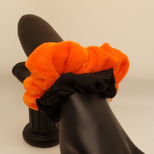 Orange velvet and black scrunchies