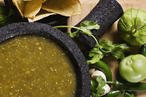 Green Roots Meals Salsa Verde in a mortar with pestle