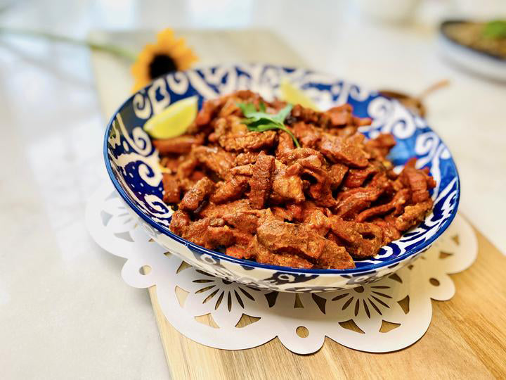 Al pastor marinated pork in bowl