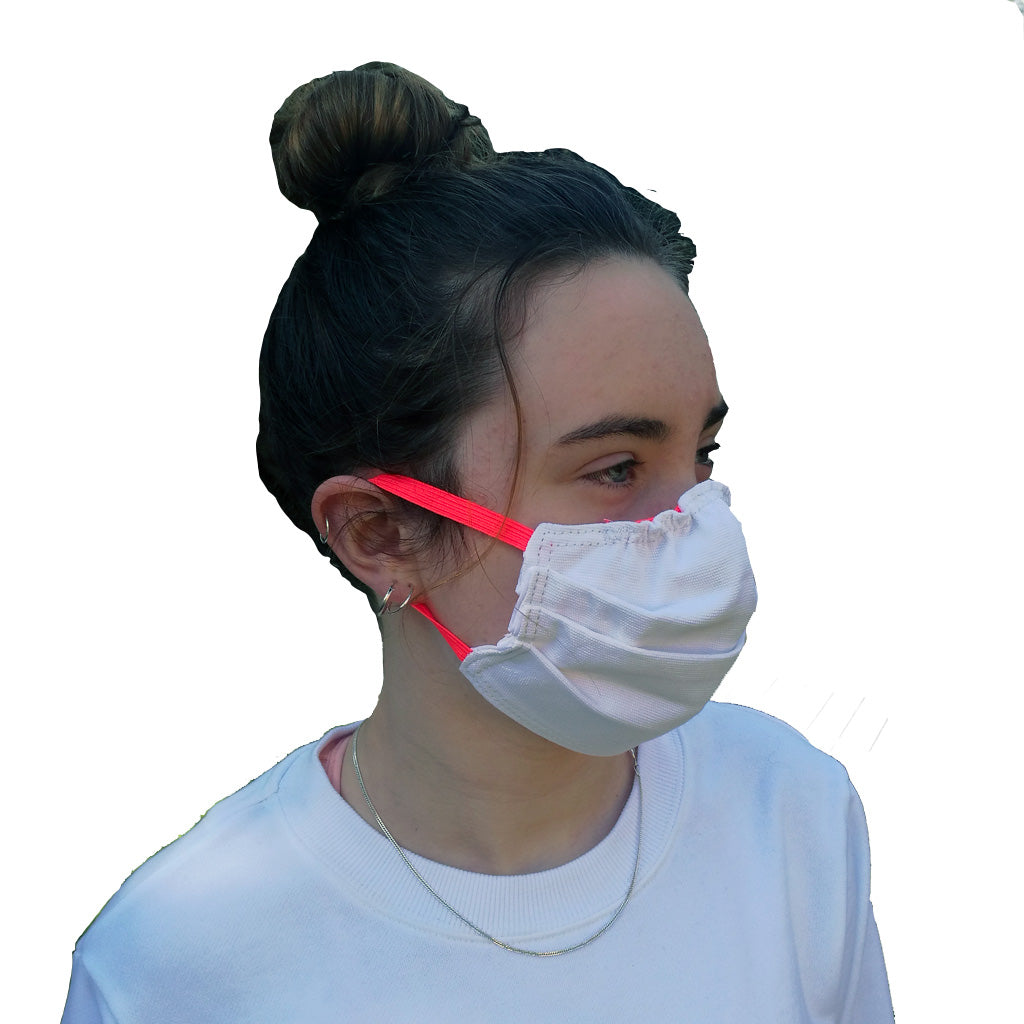 Girl wearing white face mask with pink elastic