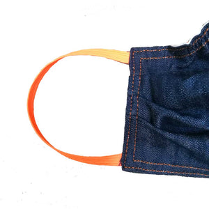 Close up of denim face mask stitching and elastic
