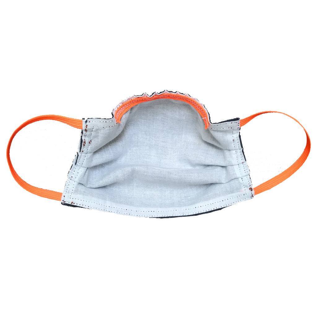 Inside view of denim face mask with orange elastic