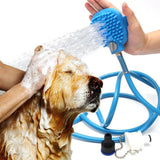 A dog is being washed with a blue pet bathing hose with brush