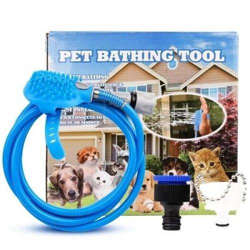 A pet bathing kit. It shows a hose with brush and 2 faucets. The packaging box is in the background.