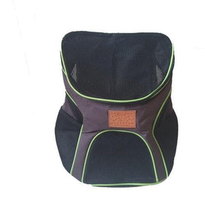 A black backpack pet carrier bag with lime trimming and mesh material.