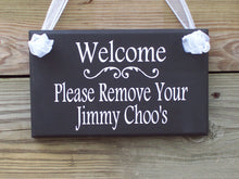Load image into Gallery viewer, Welcome Please Remove Your Jimmy Choo's Wooden Vinyl Sign Remove Your Shoes Take Off Shoes Door Hanger Wreath Sign Door Sign Door Decor Sign