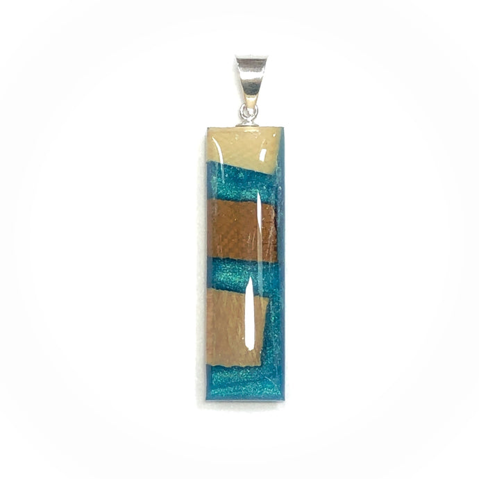 Arctic Aqua rectangle resin and mammoth ivory tooth pendant  Edit alt text