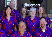 Tiemart family wearing matching Hawaiian shirts