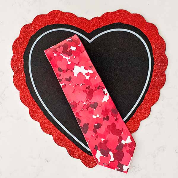 Necktie with red hearts displayed on a red heart