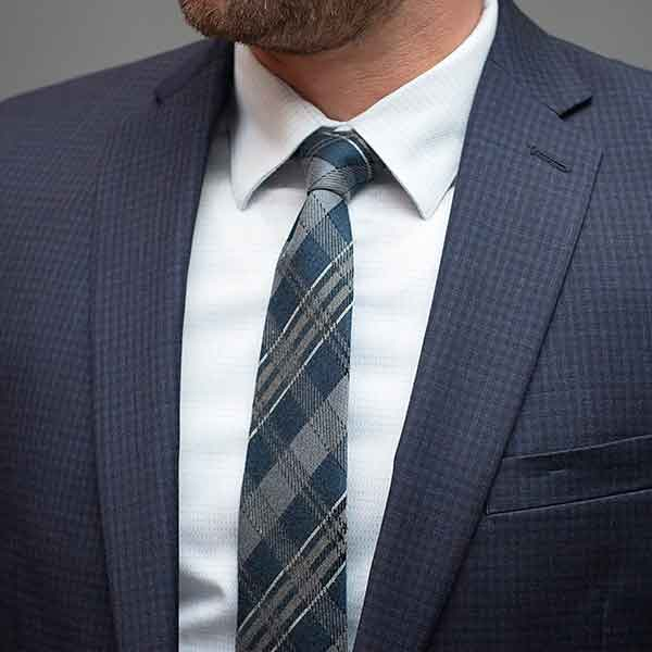 Man wearing a navy blue and gray plaid necktie