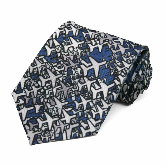 A tie with scattered airplanes on a dark blue background.