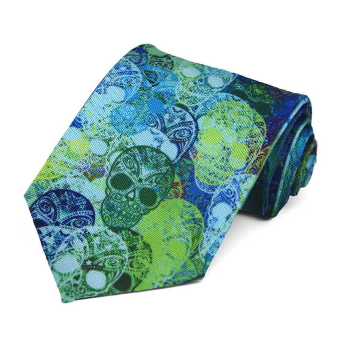 Blue and green sugar skulls randomly on a tie.
