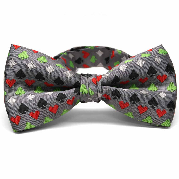 Green, white, black and red card suit casino pattern bow tie on gray background