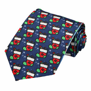 Red and green Christmas stockings tiled on a dark blue tie.