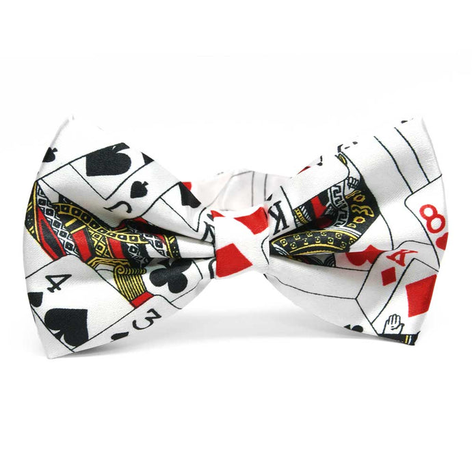 Playing cards spade, heart, diamond and clubs theme in a white bow tie.