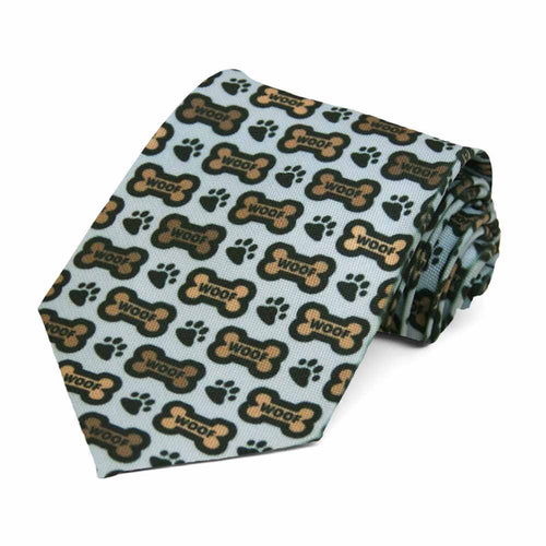 A tiled dog treat and paw on a light blue tie.